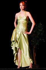 bride(0.0), bridal clothing(0.0), gown(0.0), cocktail dress(0.0), wedding dress(0.0), bridesmaid(0.0), prom(0.0), model(1.0), clothing(1.0), woman(1.0), fashion(1.0), satin(1.0), formal wear(1.0), fashion design(1.0), dress(1.0),