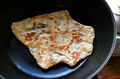 meal(0.0), bread(0.0), gã¶zleme(0.0), produce(0.0), breakfast(1.0), flatbread(1.0), paratha(1.0), tortilla(1.0), roti prata(1.0), baked goods(1.0), food(1.0), dish(1.0), quesadilla(1.0), roti(1.0), naan(1.0), roti canai(1.0), cuisine(1.0), chapati(1.0),