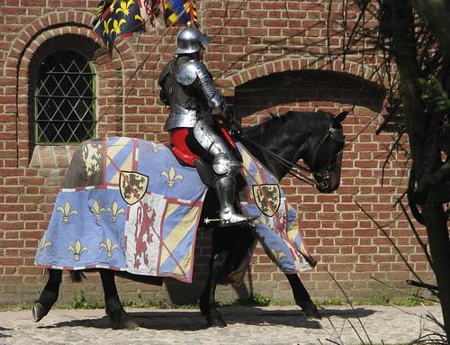 knight riding through the medieval town