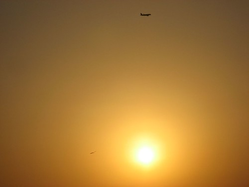 Plane at the top end, Sunset at Juhu Beach