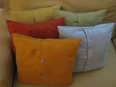 duvet cover(0.0), bed sheet(0.0), orange(1.0), textile(1.0), furniture(1.0), yellow(1.0), pillow(1.0), throw pillow(1.0), cushion(1.0),