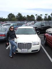 Michelle modeling our cool rental car (Chrysler 300)