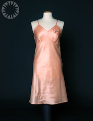 bridal clothing(0.0), gown(0.0), collar(0.0), sleeve(0.0), cocktail dress(0.0), formal wear(0.0), wedding dress(0.0), bridesmaid(0.0), pink(0.0), neck(1.0), textile(1.0), clothing(1.0), outerwear(1.0), fashion(1.0), satin(1.0), dress(1.0),