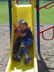 swing(0.0), city(0.0), outdoor play equipment(1.0), yellow(1.0), play(1.0), outdoor recreation(1.0), playground slide(1.0), public space(1.0), playground(1.0),