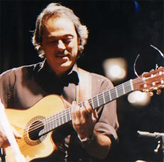 bassist(0.0), slide guitar(0.0), bass guitar(0.0), singing(0.0), string instrument(1.0), musician(1.0), music(1.0), acoustic guitar(1.0), guitarist(1.0), guitar(1.0), jazz guitarist(1.0), entertainment(1.0), performance(1.0), string instrument(1.0),