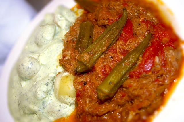 Greek-style stew with beef, tomato and herbs served with an okra ...