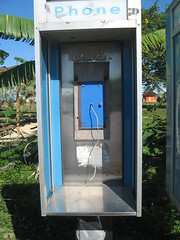 outdoor structure(0.0), public toilet(0.0), portable toilet(0.0), telephone booth(0.0), payphone(0.0), kiosk(1.0),