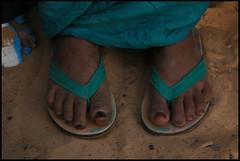 hand(0.0), outdoor shoe(0.0), shoe(0.0), green(0.0), human body(0.0), footwear(1.0), turquoise(1.0), sandal(1.0), teal(1.0), limb(1.0), leg(1.0), blue(1.0),
