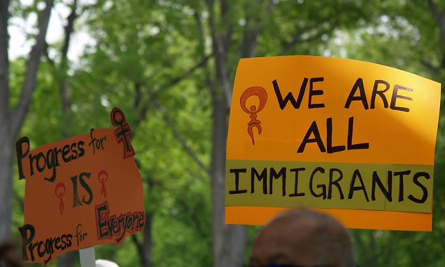 """Progress For Women Is Progress For Everyone"" & ""We Are All Immigrants"" Signs At The May Day Immigration Rights Rally (Washington, DC) from Flickr via Wylio"