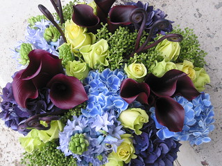 vase arrangement with purple callas, hydrangea, etc
