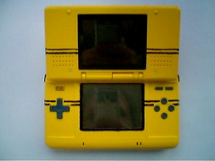 all game boy console(0.0), yellow(1.0), video game console(1.0), handheld game console(1.0), gadget(1.0), nintendo ds(1.0),
