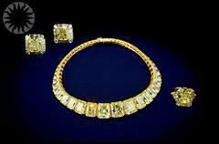 bangle(0.0), yellow(1.0), metal(1.0), jewellery(1.0), diamond(1.0), gemstone(1.0), gold(1.0), circle(1.0), bling-bling(1.0),