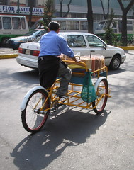 rickshaw(0.0), sports equipment(0.0), motorcycle(0.0), motorcycle speedway(0.0), bicycle(0.0), bicycle trailer(1.0), wheel(1.0), vehicle(1.0), mode of transport(1.0), land vehicle(1.0),