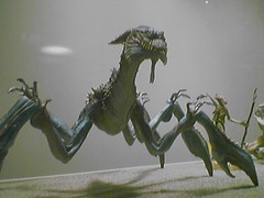 army men(0.0), velociraptor(0.0), sculpture(0.0), art(1.0), fauna(1.0), dragon(1.0), dinosaur(1.0),