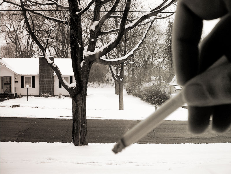 an image of cigarette in black and white winter scene