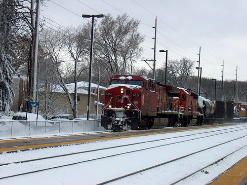 Eastbound Canadian Pacific freight train passing through Christmas card scenery. Photographed at the northwest suburban Metra River Grove Illinois commuter rail station. by Eddie from Chicago