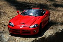 muscle car(0.0), race car(1.0), automobile(1.0), automotive exterior(1.0), wheel(1.0), vehicle(1.0), performance car(1.0), automotive design(1.0), land vehicle(1.0), srt viper(1.0), supercar(1.0), sports car(1.0),