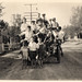 vintage: kids piled on a car