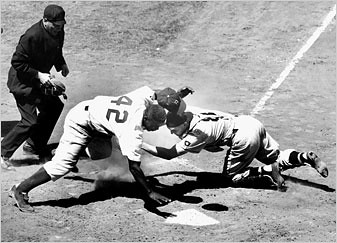 Jackie Robinson stealing home plate for the Brooklyn Dodgers. 2007 represents the 60th anniversary of the integration of Major League Baseball. This resulted from a civil rights campaign involving the NAACP, Paul Robeson and many others. by Pan-African News Wire File Photos