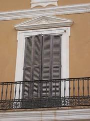 sash window(0.0), baluster(0.0), siding(0.0), window covering(0.0), interior design(0.0), brick(0.0), column(0.0), brickwork(0.0), daylighting(1.0), window(1.0), wall(1.0), wood(1.0), handrail(1.0), molding(1.0), door(1.0), facade(1.0), balcony(1.0),