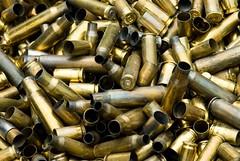 weapon(0.0), firearm(0.0), gun barrel(0.0), bullet(1.0), metal(1.0), ammunition(1.0),
