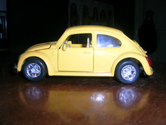 volkswagen new beetle(0.0), model car(1.0), automobile(1.0), volkswagen beetle(1.0), automotive exterior(1.0), wheel(1.0), vehicle(1.0), automotive design(1.0), subcompact car(1.0), city car(1.0), sedan(1.0), land vehicle(1.0),