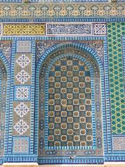 tapestry(0.0), textile(0.0), prayer rug(0.0), design(0.0), carpet(0.0), flooring(0.0), art(1.0), mosaic(1.0),