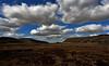 Clouds in a gradient blue sky