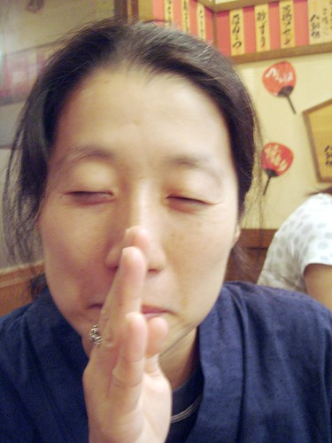 "Yasuko making gesture for ""Please"""