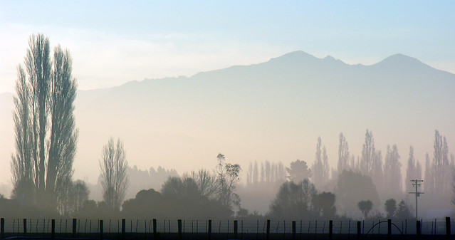 Fog clearing, South Canterbury, New Zealand, 5 August 2005 from Flickr via Wylio