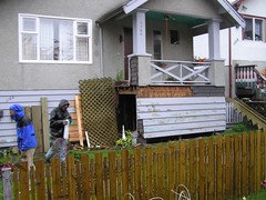 backyard(0.0), outdoor structure(0.0), porch(0.0), picket fence(1.0), wood(1.0), property(1.0), yard(1.0), cottage(1.0), house(1.0), siding(1.0), residential area(1.0), home(1.0),