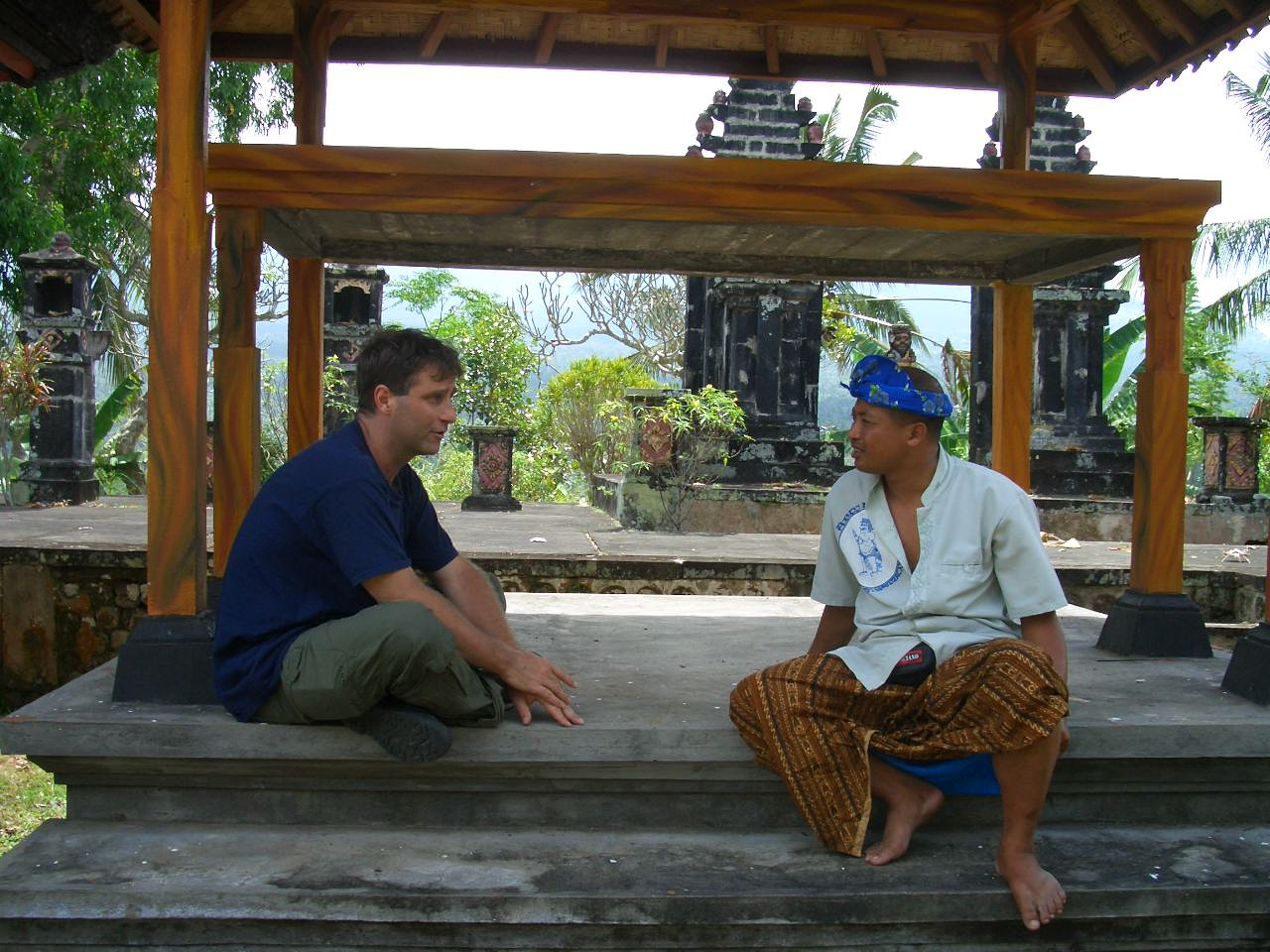Learning about Balinese religion, near Tirtagangga