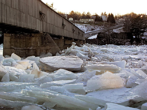 ice jam threatening a covered bridge