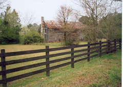 ranch(0.0), gate(0.0), outdoor structure(1.0), home fencing(1.0), wall(1.0), picket fence(1.0), split rail fence(1.0), property(1.0), real estate(1.0), pasture(1.0),