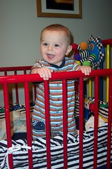 standing up in his crib!
