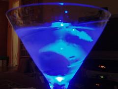 purple(0.0), martini(0.0), lighting(0.0), distilled beverage(1.0), light(1.0), cobalt blue(1.0), glass(1.0), blue hawaii(1.0), drink(1.0), cocktail(1.0), blue(1.0), alcoholic beverage(1.0),