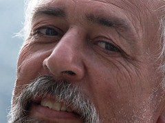 ear(0.0), human body(0.0), portrait(0.0), nose(1.0), face(1.0), facial hair(1.0), skin(1.0), male(1.0), man(1.0), head(1.0), hair(1.0), cheek(1.0), close-up(1.0), wrinkle(1.0), mouth(1.0), adult(1.0), beard(1.0), eye(1.0), organ(1.0),