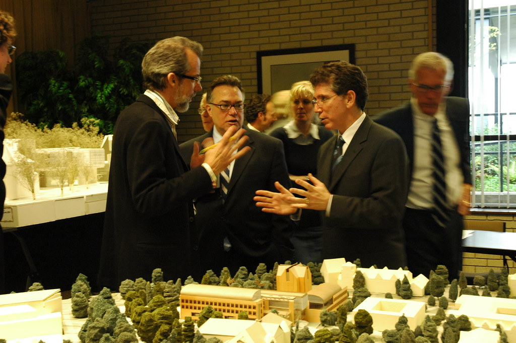 Architect, Dean of the Business School, Dean of the School of Architecture, discussing plan with model, other architects, UW Architectural Commission, University of Washington, Seattle, Washington, USA
