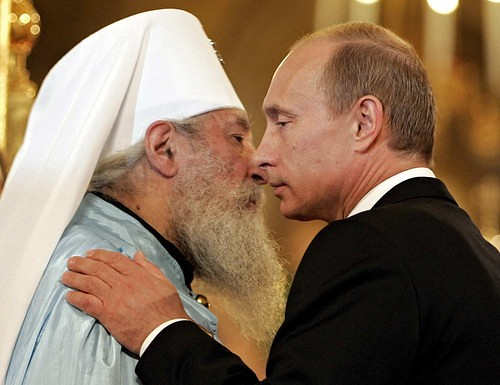 Russian President Vladimir Putin, right, and Metropolitan Laurus, head of the Russian Orthodox Church, during the ceremony marking the end of an 80-year split over Soviet control of the Orthodox Church.