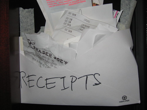 "Receipts stuffed in envelope labeled ""receipts."""