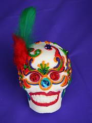 clothing(0.0), performing arts(0.0), costume(0.0), clown(0.0), mask(0.0), headgear(0.0), masque(1.0), head(1.0),