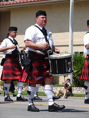clothing, tradition, musical instrument, kilt, drum, costume,