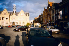 Grote Markt in Ieper with Menin Gate in the distance