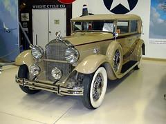 touring car(0.0), cadillac v-16(0.0), sedan(0.0), automobile(1.0), rolls-royce phantom iii(1.0), vehicle(1.0), antique car(1.0), vintage car(1.0), land vehicle(1.0), luxury vehicle(1.0), convertible(1.0), motor vehicle(1.0), classic(1.0),