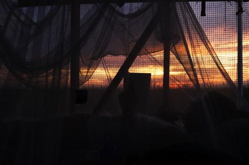 ben friend eastcamp everglades florida 2005 unfound sunset silhouette camp read book sleep dark light geolat25507164 geolon80691319 geotagged