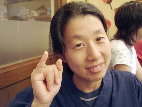 "Yasuko making gesture for ""lover"""