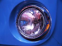 window(0.0), wheel(0.0), rim(0.0), alloy wheel(0.0), spoke(0.0), automobile(1.0), automotive exterior(1.0), automotive lighting(1.0), light(1.0), bumper(1.0), headlamp(1.0), circle(1.0),