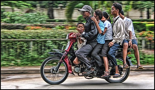 Six on a motorbike.... Phnom Penh, Cambodia