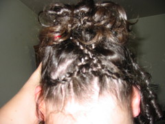 forehead(0.0), hairstyle(1.0), chignon(1.0), french braid(1.0), hair(1.0), brown hair(1.0), braid(1.0),