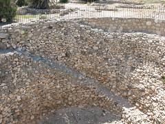 asphalt(0.0), wall(0.0), stream bed(0.0), walkway(0.0), gravel(0.0), stone wall(1.0), soil(1.0), rubble(1.0), cobblestone(1.0), rock(1.0),